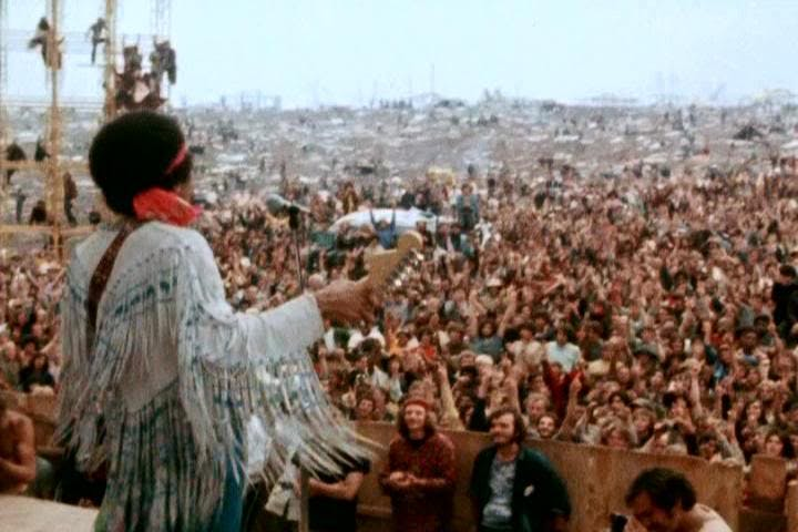 Jimi Hendrix playing at Woodstock
