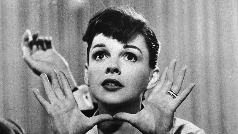 American actor and singer Judy Garland (1922-1969) holds her hands up near her face, circa 1950s.(Photo by Hulton Archive/Getty Images)