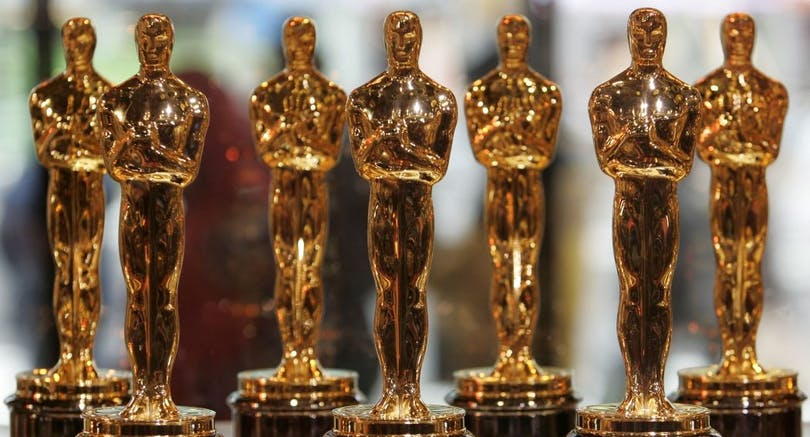"""Part of a display of 50 Oscar statuettes on February 15, 2008 at a """"Meet the Oscars"""" event in New York's Times Square. The Academy Awards ceremony is February 24 in Los Angeles. AFP PHOTO/Stan HONDA"""