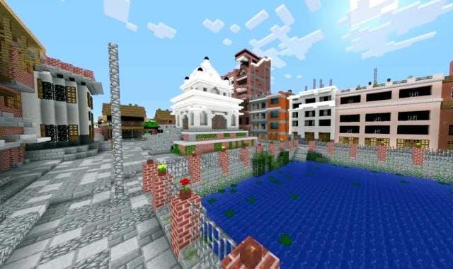 Ett vattendrag och byggnader. Allt uppbyggt i spelet Minecraft