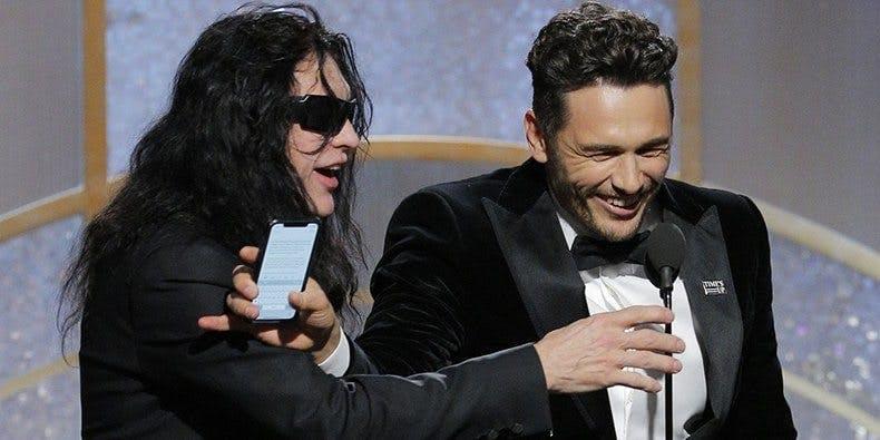 Tommy Wiseau och James Franco på scen under Golden Globes-galan