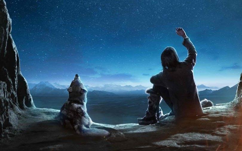 Bild på Kodi Smit-McPee och hans käre vargkompis från filmen Alpha.