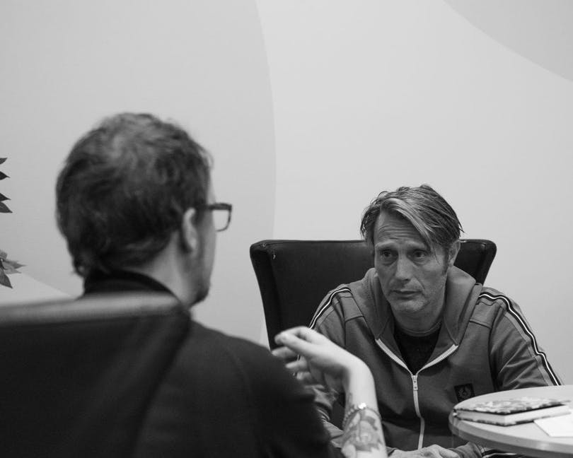 Eric Diedrichs and Mads Mikkelsen are discussing acting.