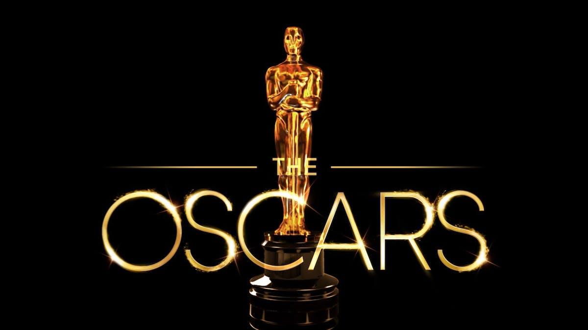Oscarsstatyett mot svart bakgrund