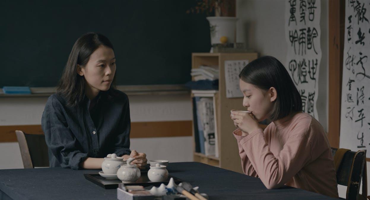 Eunhee dricker te med sin nya favoritlärare