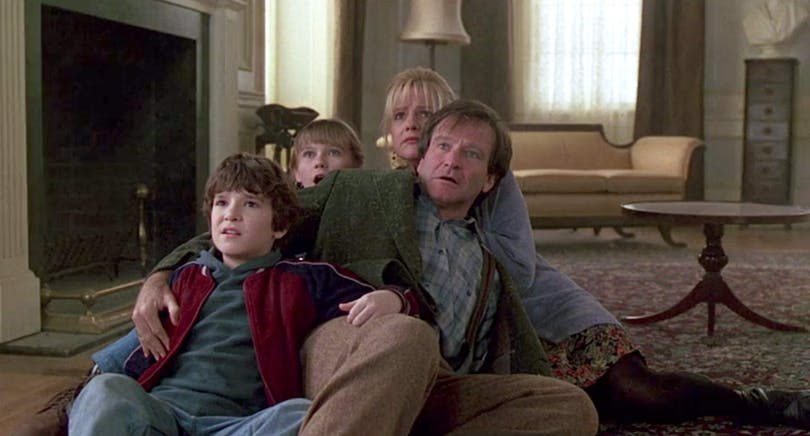 Robin Williams, Bradley Pierce, Bonnie Hunt och Kirsten Dunst i Jumanji.